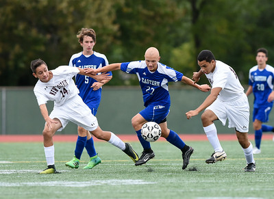 09/19/17 Wesley Bunnell | Staff  Bristol Eastern boys soccer defeated New Britain 7-0 on Tuesday afternoon at Veteran's Stadium in New Britain. Bristol Eastern's Lyle Winiarski #27, center, battles two New Britain played including Minel Mehmedovic (14) and Kevin Carrasavillo (12).