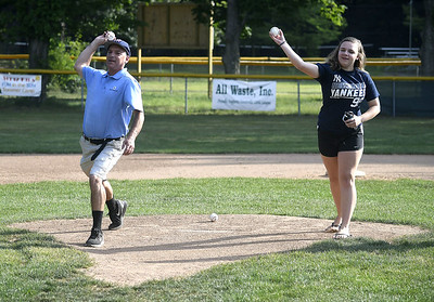 8/1/2017 Mike Orazzi | Staff Bob Watson's son in law Dave Frechette and great grand daughter Sydney Frechette throw out the first pitches during the Bob Watson Little League tournament held at Peck Park Tuesday at the Forestville Little League.