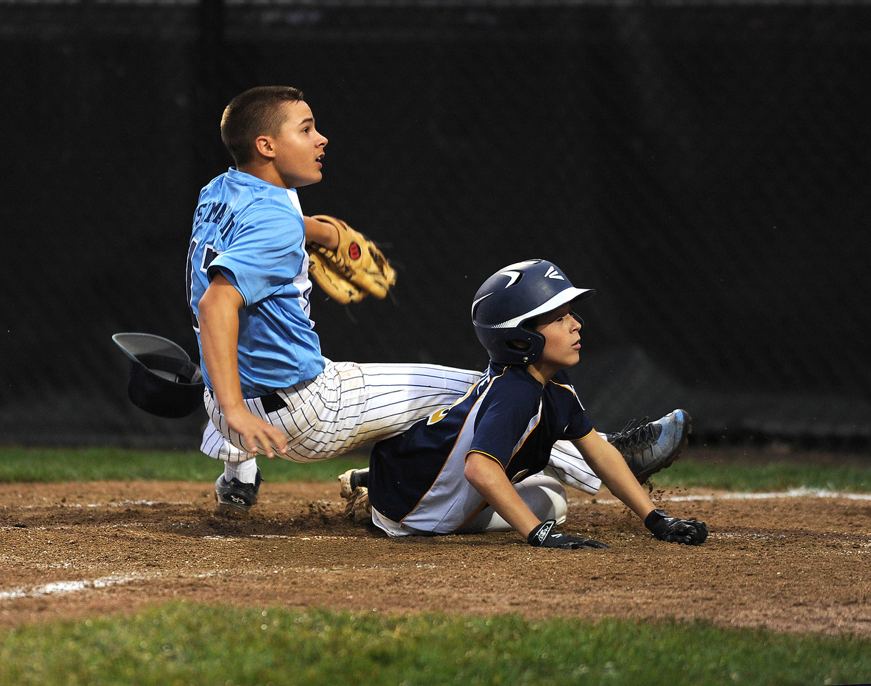 8/7/2017 Mike Orazzi | Staff Maryland's Logan Simanski (17) as Pennsylvania's Cam Paquette (9) during the Eastern Regional Little League Tournament in Bristol Monday evening.