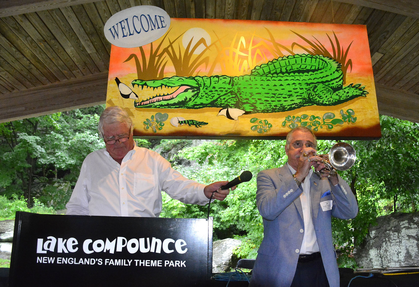 8/21/2015 Mike Orazzi | Staff Ray Dunaway as State Rep Frank Nicastro plays his trumpet during the Crocodile Club's 134th reunion dinner held at Lake Compounce on Friday afternoon.