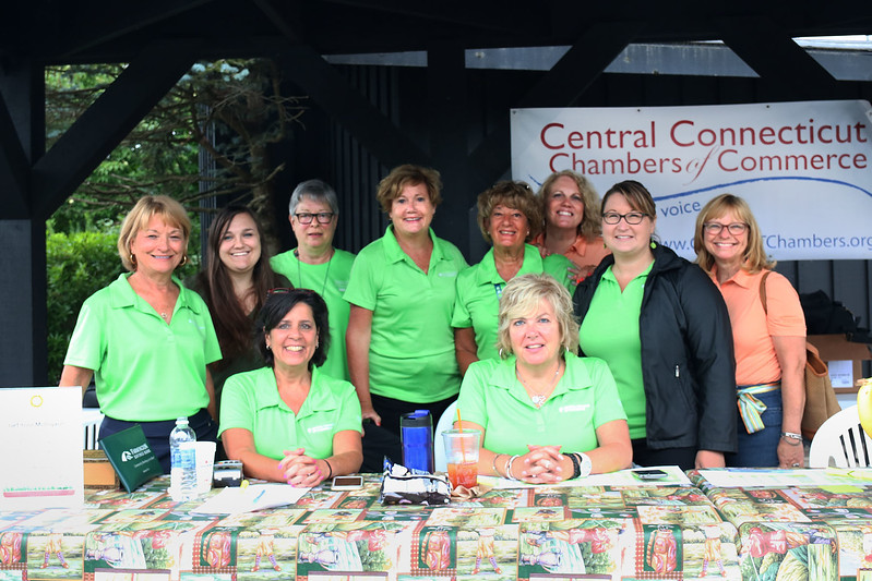 The Connecticut Chamber of Commerce members and volunteers pose at the registration table for the 26th Annual Golf Tournament.