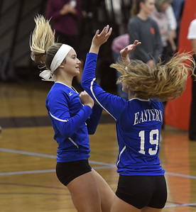 10/26/2017 Mike Orazzi | Staff Bristol Eastern's Zoe Lowe (7) and Amber Blais (19) during Thursday night's volleyball match at BC.