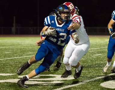 10/06/17  Wesley Bunnell | Staff  Berlin football vs Plainville at Plainville High School on Friday night. Plainville running back Brady Callahan (22) being pursued by Berlin offensive lineman Kevin Stafstrom (57).