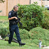 09/21/17 Wesley Bunnell | Staff<br /> <br /> A West Hartford police officer stands near the intersection of Fisk & Lloyd St in Newington on Thursday morning due to a police standoff on nearby Gilbert Rd.