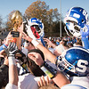 11/23/17  Wesley Bunnell | Staff<br /> <br /> Southington football topped Cheshire on Thanksgiving morning in the Apple Valley Classic at Cheshire High School.  Players hoist their helmets and trophy.