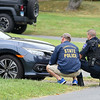 09/21/17 Wesley Bunnell | Staff<br /> <br /> A state police officer & a West Hartford police officer crouch near the intersection of Fisk & Lloyd St in Newington on Thursday morning due to a police standoff on nearby Gilbert Rd.