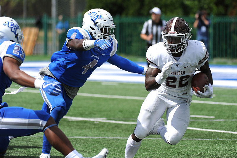 9/9/2017 Mike Orazzi | Staff<br /> CCSU's Randall LaGuerre (4) and Fordham's Chase Edmonds (22) during Saturday's game in New Britain.