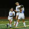 10/30/17  Wesley Bunnell | Staff<br /> <br /> Bristol Central @ Bristol Eastern on Monday evening at Bristol Eastern High School. Myah Croze (9) and Brooke Dauphinee (19) congratulate freshman Kate Kozikowski (10) after scoring a goal.