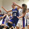 12/14/2017 Mike Orazzi | Staff<br /> Bristol Eastern's Meredith Forman (10) and Plainville's Isabel Lozefski (10) Thursday night in Plainville.