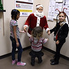 12/15/2017 Mike Orazzi | Staff<br /> Kaylee Ambert,8, Soliyi Green and Bella Nuzzo during a Christmas party Friday afternoon in Bristol at the Human Resources Agency of Bristol.