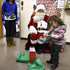 12/15/2017 Mike Orazzi | Staff<br /> Soliyi Green opens his gifts during a Christmas party Friday afternoon in Bristol at the Human Resources Agency of Bristol.