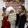 12/15/2017 Mike Orazzi | Staff<br /> Bella Nuzzo,7, thinks about what she may want for Christmas during a Christmas party Friday afternoon in Bristol at the Human Resources Agency of Bristol.