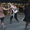 12/16/2017 Mike Orazzi | Staff<br /> Granite State Saber Academy's and Kristal Terpstra, Adrian Johnson and Dan DuBois during a lightsaber battle at the Star Wars event at the Southington Public Library Saturday afternoon.