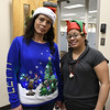 12/15/2017 Mike Orazzi | Staff<br /> HRA's Lori Keller and Milly Martinez during a Christmas party for area needy families.