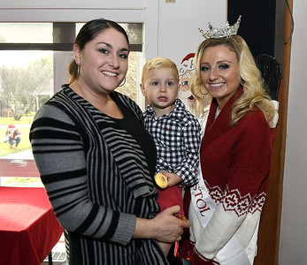 12/2/2017 Mike Orazzi | Staff Sara Aparo and her son Daniel with Miss Bristol 2018 Victoria Lemme during the 24th Annual Breakfast with Santa at Giamatti Little League Center Saturday morning.