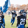 11/23/17  Wesley Bunnell | Staff<br /> <br /> Plainville football was defeated by Farmington on Thanksgiving morning for The Olde Canal Cup. Justin Ciotto (55) runs with the Plainville flag across the sideline.