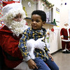 12/15/2017 Mike Orazzi | Staff<br /> Jamai Owens,3, with Santa during a Christmas party Friday afternoon in Bristol at the Human Resources Agency of Bristol.
