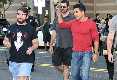 080917  Wesley Bunnell | Staff  Filming began at Amato's Toy & Hobby Store on Main St on Wednesday afternoon for a movie starring Mario Lopez and Melissa Joan Hart to be released in December 2017. Mario Lopez makes his way across Main St from City Hall to the set in Amato's.