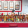 12/11/17  Wesley Bunnell | Staff<br /> <br /> Firehouse Subs opened for business on Monday at their new location at 594 Farmington Ave. Jason Lombardi stands behind bottles of hot sauce.