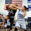 1/18/2018 Mike Orazzi | Staff<br /> Bristol Central's Ideara Gordon (21) and  Bristol Eastern's Avery Arbuckle (42) during the girls basketball game at BEHS Thursday night.