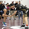 1/6/2018 Mike Orazzi | Staff <br /> Bristol Eastern's Diego Fernandez and East Hartford's Oscar Souvannavong in a 145 match during the Bristol Central High School Invitational wrestling match Saturday in Bristol.