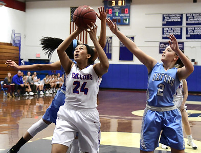 2/3/2017 Mike Orazzi | Staff St. Paul's Jade Udoh (24) and Oxford's Kelly Shpak (2) Friday night in Bristol.