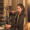 Athena Gallagher, bartender, pours a beer on tap at Firefly Hollow Brewing.
