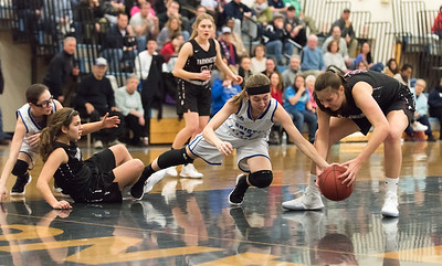 01/02/18  Wesley Bunnell | Staff  Bristol Eastern basketball fell to Farmington Tuesday evening 48-46 at Bristol Eastern High School. Hannah Maghini (11) fights for an offensive rebound.