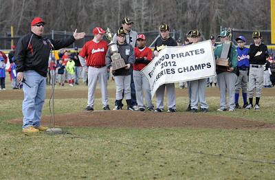 4/13/2013 Mike Orazzi | Staff Edgewood Little League President Mark Tonon acknowledges the Edgewood Pirates at the 2012 City Series champions during Saturday's opening day ceremony at Bristol's Edgewood Little League.