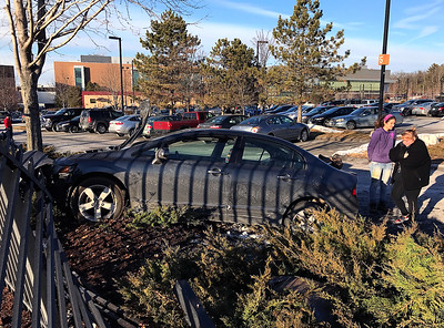 car-goes-off-road-and-crashes-into-espn-fence