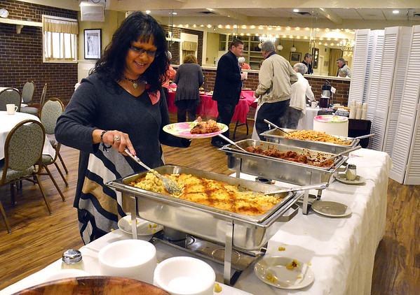 4/17/2015 Mike Orazzi | Staff Annette Sheoraj of Lane Construction during the Zion Evangelical Church's recognition luncheon for volunteers who help the Meals for the Needy program, Bristol's oldest soup kitchen soup, during an event at Nuchie's Friday afternoon.