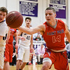 031317  Wesley Bunnell | Staff<br /> <br /> St. Paul boys basketball was defeated in a Class S CIAC playoff game against Westbrook on Monday March 13. Tyler Arbuckle (14)