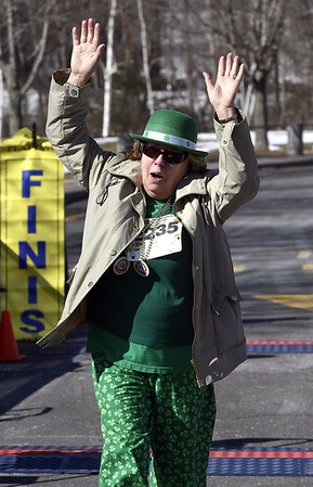 3/17/2018 Mike Orazzi | Staff Lorraine Marti crosses the finish line in the 2 mile run and walk during the 16th Annual Shamrock Run and Walk held at the Chippens Hill Middle School Saturday morning.