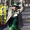 3/17/2018 Mike Orazzi | Staff<br /> Lorraine Marti crosses the finish line in the 2 mile run and walk during the 16th Annual Shamrock Run and Walk held at the Chippens Hill Middle School Saturday morning.