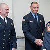 01/22/18  Wesley Bunnell | Staff<br /> <br /> The Bristol Fire Department honored two of their own on Monday evening for helping save the life of an elderly woman.  Lt. Lance Lavore, L, and FF Adam Hayes are shown standing as Deputy Chief John Ziogas reads their citations during the fire commission meeting at city hall.