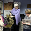 4/20/2018 Mike Orazzi | Staff<br /> Helen Ayer Patton returns Herman James Perry's World War II backpack to Dorothy Perry and her daughters Cheryl Chumney and Judy Kirschner at the Bristol Senior Center Friday.
