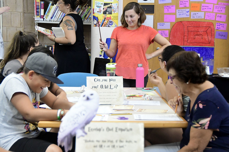 7/31/2018 Mike Orazzi | Staff Assistant Children's Librarian Christina Carpino leads activities while celebrating  Harry Potter's birthday during Harry Potter Day at the  Manross Library in Forestville Tuesday afternoon.