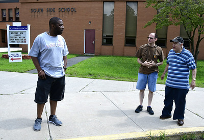8/14/2018 Mike Orazzi | Staff Ian West talks with Al Cianchetti III and Al Cianchetti Jr. about Tuesday's candidates after voting at the South Side School in Bristol.