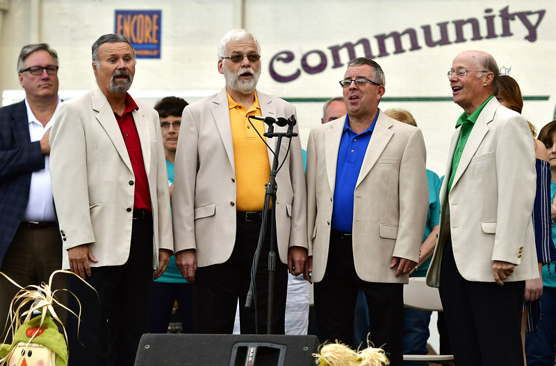 9/20/2018 Mike Orazzi | Staff Barbershop quartet, Off the Chart performs the Star Spangled Banner during the Mum Festival on Memorial Blvd. Thursday evening.