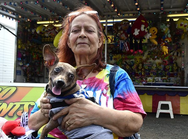 4/29/2017 Mike Orazzi | Staff<br /> Hilda Rosario and her dog Mickey Mouse during the United Way carnival in downtown Bristol Saturday.