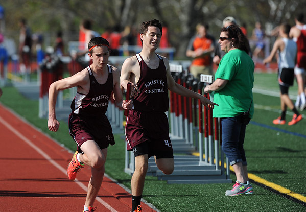 4/28/2017 Mike Orazzi | Staff<br /> Bristol Central's Adam Chawner hands off to Matt Roy in the 4x800 during the Bristol Central Invitational Track Meet in Bristol Friday.