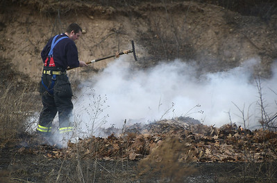 3/3/2017 Mike Orazzi | Staff Bristol firefighters extinguish a brush fire along Farrell Avenue in Bristol Friday afternoon.