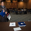 030117  Wesley Bunnell | Staff<br /> <br /> CCSU held an informative panel titled Uncertainty around Immigration Law on March 1. Masters student Diana-Kay Walters takes an informational packet for immigrants at a back table set up for guests.