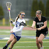 4/7/2016 Mike Orazzi | Staff<br /> Southington's Sydney Brault (3) during Thursday's lacrosse with the Bristol co-op's Allie Godau (19).