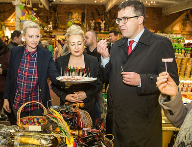 Sylwia Kaczorek, left, and Anna Piotrkowicz, both managers at Roly Poly Baker and Deli Market, offer some samples of kielbasa to Piotr Wilczek, Poland's ambassador to the United States, as he began a tour of Little Poland in New Britain on April 1, 2017.