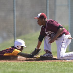 4/13/2016 Mike Orazzi | Staff New Britain High School's Daniel Rivera (2) dives back to first as Bristol Central High School's Jordan Banks (21) Wednesday afternoon.
