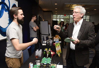 4/1/2017 Mike Orazzi | Staff Shebeen Brewing Company Derek Ives serves a beer sample to Jeff Hahn during the Bristol Hospital Development Foundation's Festival of Wines & Spirits held at the DoubleTree by Hilton in Bristol Saturday night. The money raised this year will go toward a future renovation project at the hospital's Emergency Center.