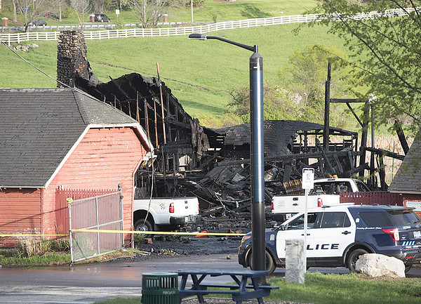 F:\DPF\Tuesday News\Storrs Horsebarn Hill Barn Fire #2 May 9 2017.jpg\Uconn firefighters and police were still on the scene of a fire that occured last night at the landscaping Services Barn located near the Uconn Dairy Bar on Horsbarn Hill Road Tuesday morning.\Roxanne Pandolfi
