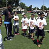 6/24/2017 Mike Orazzi | Staff<br /> Tebucky Jones works with players during a football camp held at Chesley Park in New Britain Saturday.