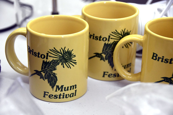 7/8/2017 Mike Orazzi   Staff Bristol Mum Festival mugs for sale during the Bristol Historical Society Tag Sale Saturday morning.